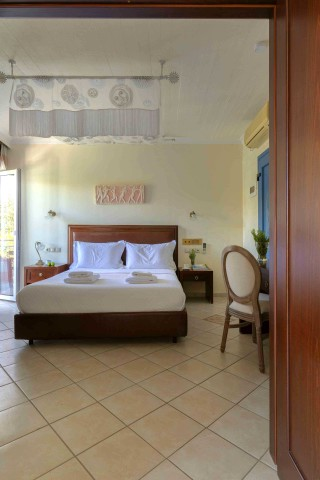 suites-aneroussa-beach-hotel-bedroom